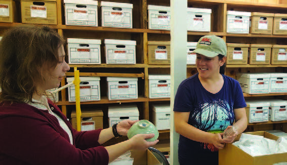 Scholarship recipients working with ASC collection